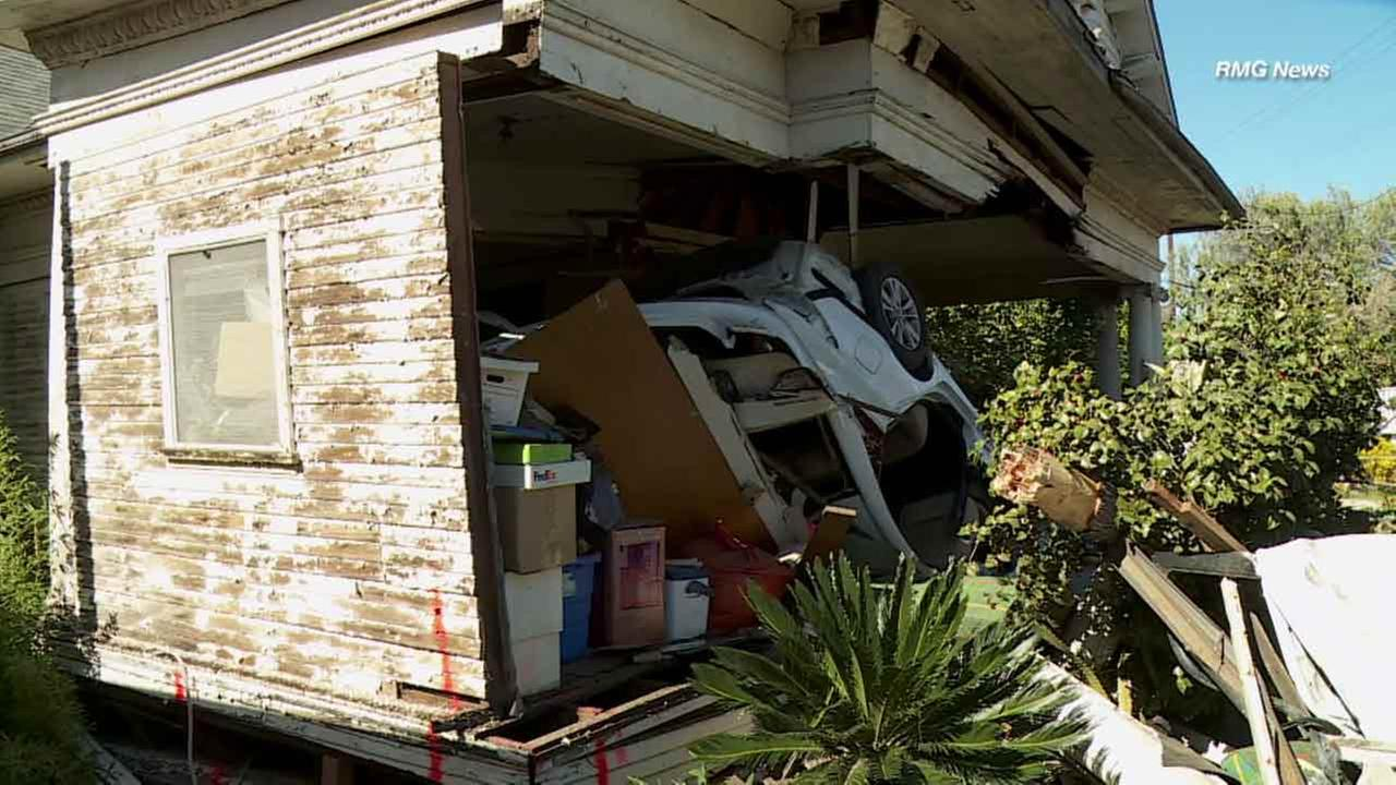 A car crashed into an unoccupied home in Boyle Heights, leaving one person dead and two other injured on Sunday, Feb. 7, 2016.