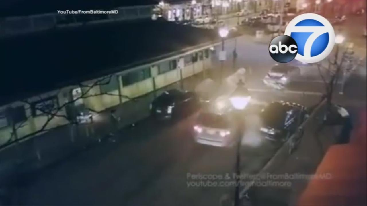 Video captured a van smashing vehicles and running over a woman in Baltimore while fleeing attackers on Saturday, Feb. 6, 2016.