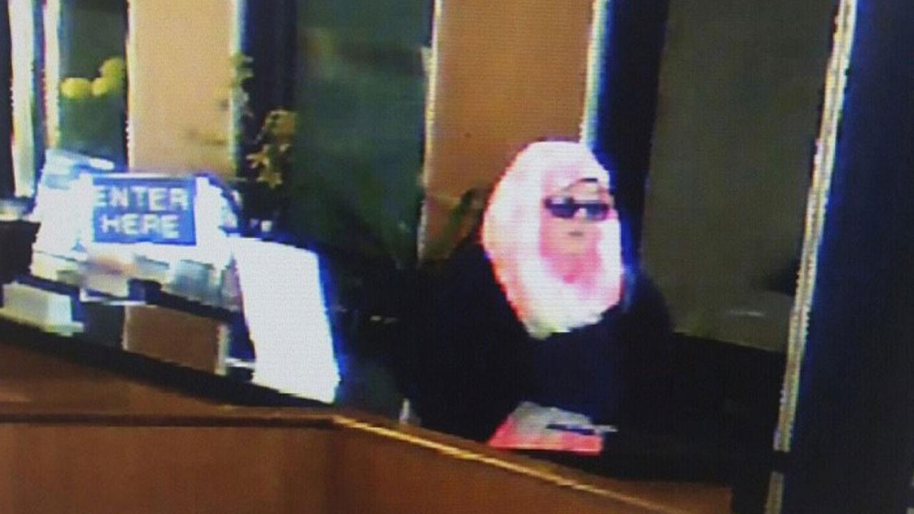 This surveillance photo shows a woman robbing the Farmers and Merchants Bank in Garden Grove on Feb. 9.