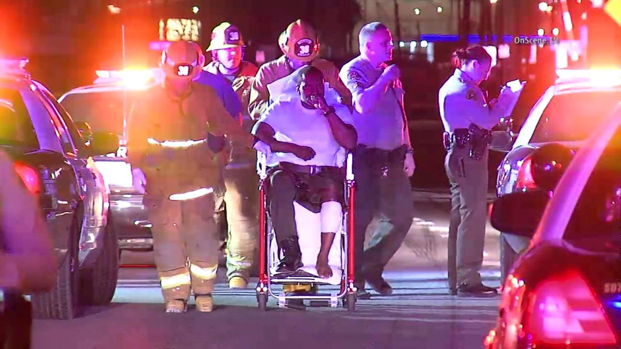 A Los Angeles County sheriffs deputy is wheeled to an ambulance after he accidentally shot himself in the leg during a pursuit in Wilmington on Wednesday, Feb. 10, 2016.