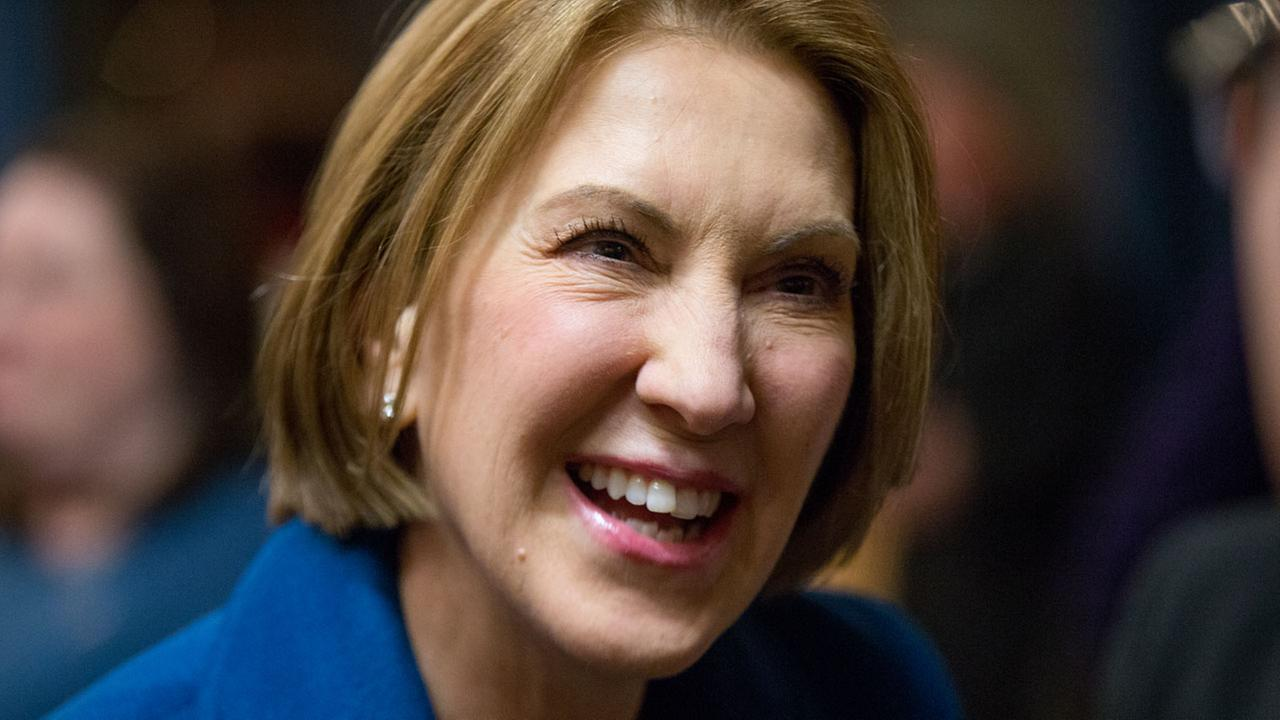 Republican presidential candidate Carly Fiorina greets guests at a welcome back reception for members of the Iowa legislature on Jan. 12, 2016.