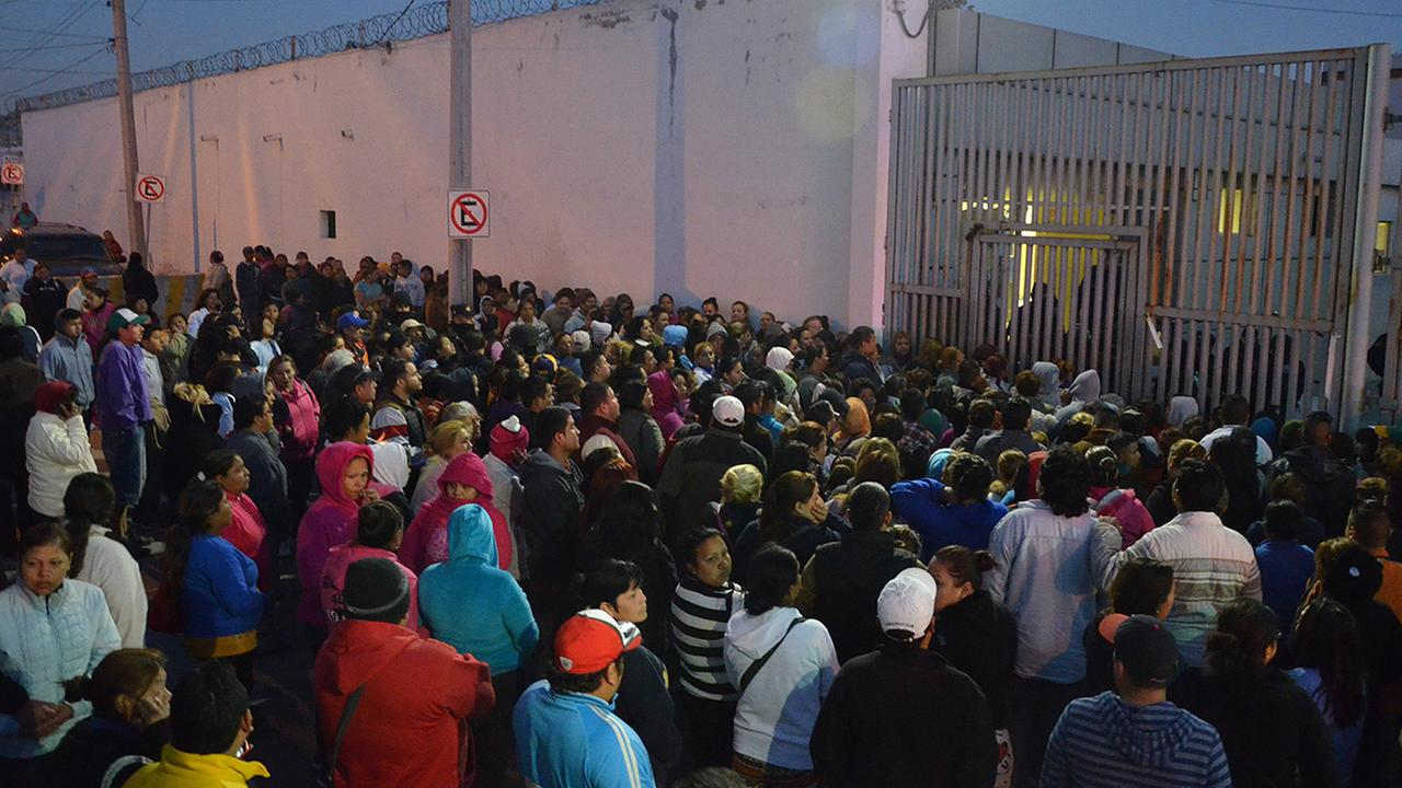 Relatives of inmates stand outside the Topo Chico prison, where a riot broke out around midnight, in Monterrey, Mexico, Thursday, Feb. 11, 2016.