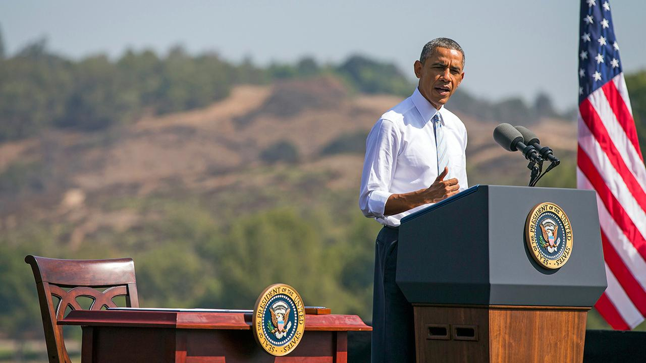 In this Oct. 10, 2014 ,file photo, President Barack Obama speaks at Frank G. Bonelli Regional Park in San Dimas, Calif.