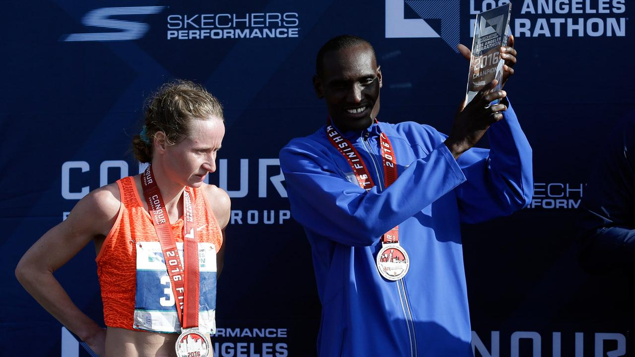 Mens winner Weldon Kirui, right, and womens winner Nataliya Lehonkova pose for pictures after the Los Angeles Marathon, Sunday, Feb. 14, 2016, in Santa Monica, Calif.