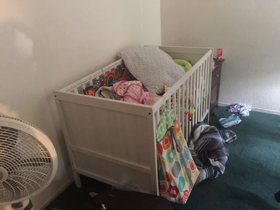 "<div class=""meta image-caption""><div class=""origin-logo origin-image none""><span>none</span></div><span class=""caption-text"">A crib filled with clothes and toys is found inside one of the rooms of a Redlands home connect to the San Bernardino shooting suspects.</span></div>"