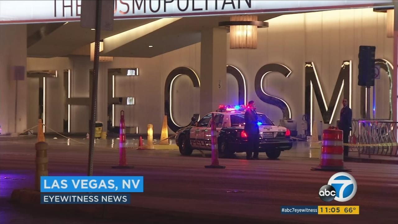 Las Vegas police respond to The Cosmopolitan hotel-casino to investigate a fatal car-to-car shooting Friday, Feb. 19, 2016.
