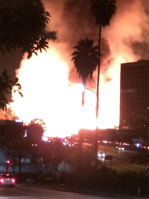 <div class='meta'><div class='origin-logo' data-origin='none'></div><span class='caption-text' data-credit='Twitter.com/@thereal_doofy'>ABC7 viewer @thereal_doofy shared a photo of the fire in downtown Los Angeles using #ABC7Eyewitness on Monday, Dec. 08, 2014.</span></div>