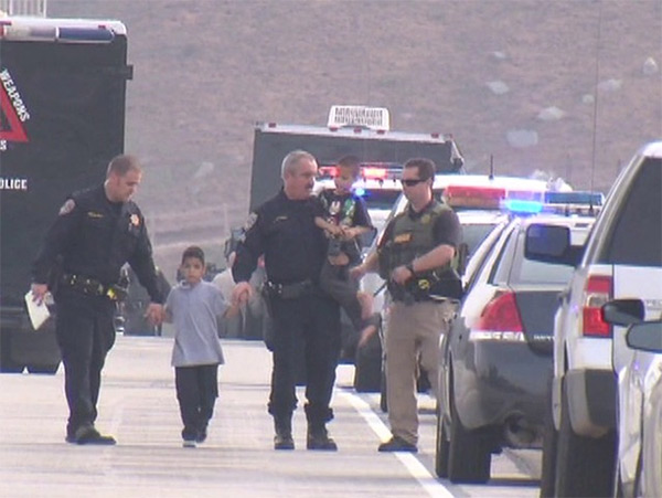 "<div class=""meta image-caption""><div class=""origin-logo origin-image ""><span></span></div><span class=""caption-text"">Officers escort two of four kids who were the subject of an Amber Alert during a standoff on a San Diego County freeway on Thursday, Dec. 11, 2014. (KGTV)</span></div>"