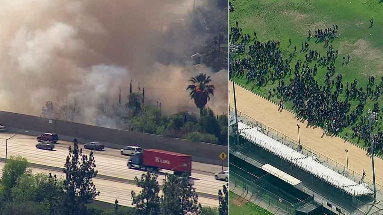 Students at John F. Kennedy High School were evacuated onto the football field after a fire erupted near the 118 Freeway in Granada Hills Tuesday, Feb. 23, 2016.