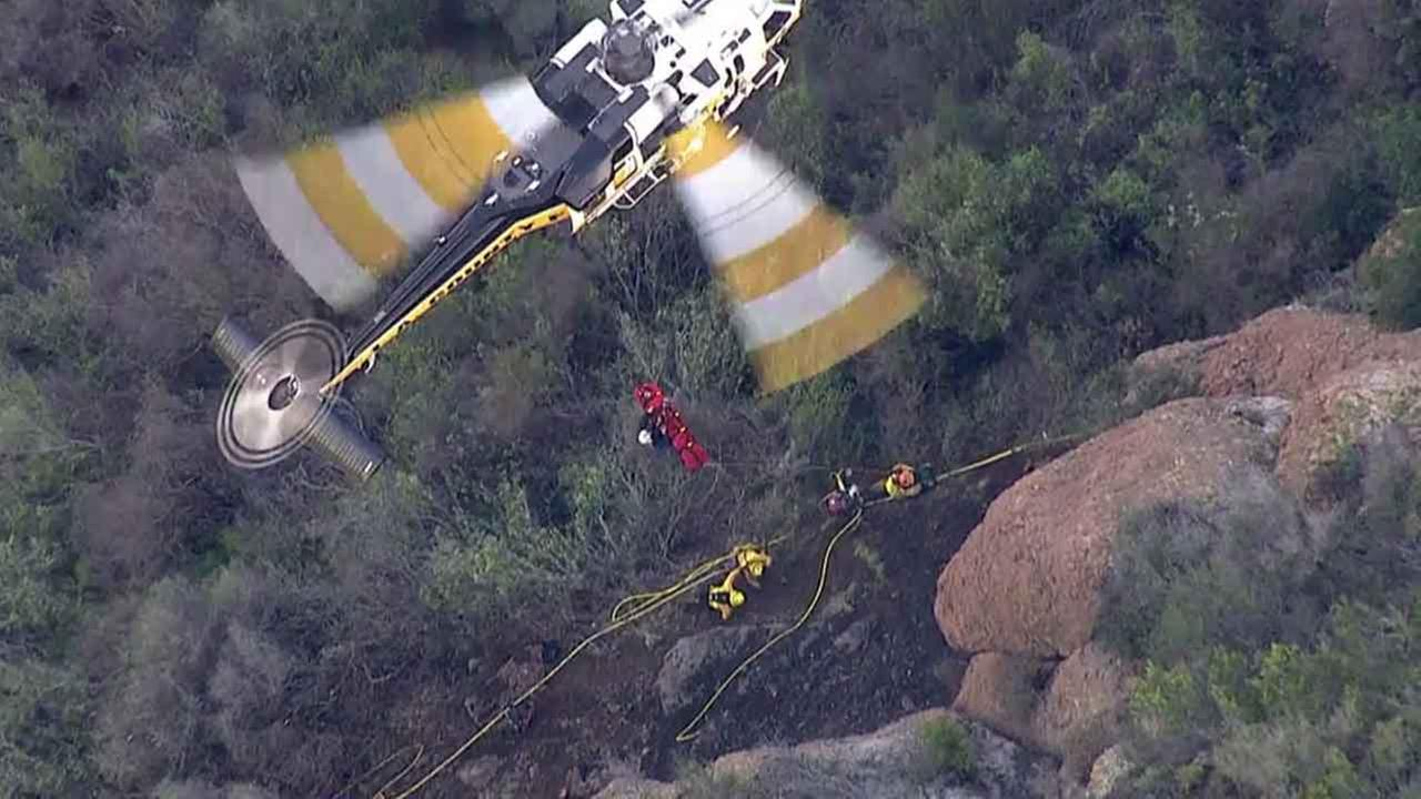 A female inmate firefighter was airlifted in critical condition after being struck in the head by a boulder while battling a brush fire in Malibu Thursday, Feb. 25, 2016.