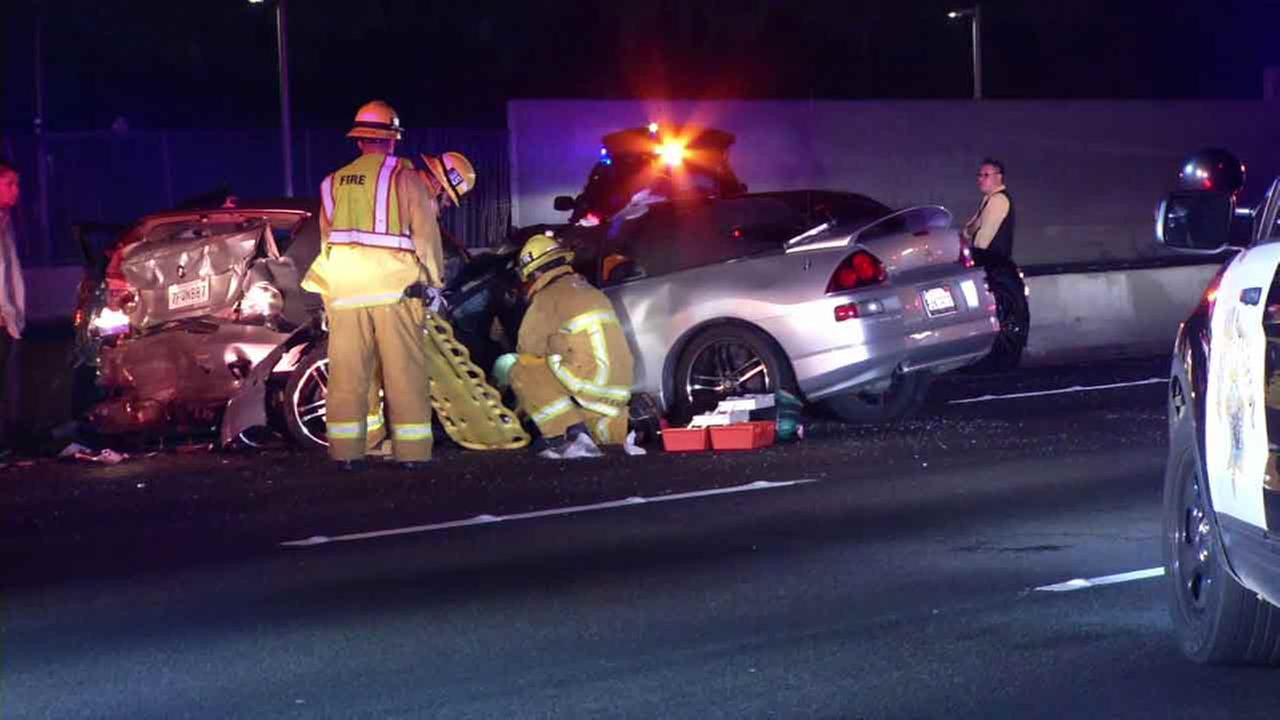 Firefighters respond to the scene of a crash near Los Feliz Boulevard on the 5 Freeway in the Atwater Village area of Los Angeles on Saturday, Feb. 27, 2016.