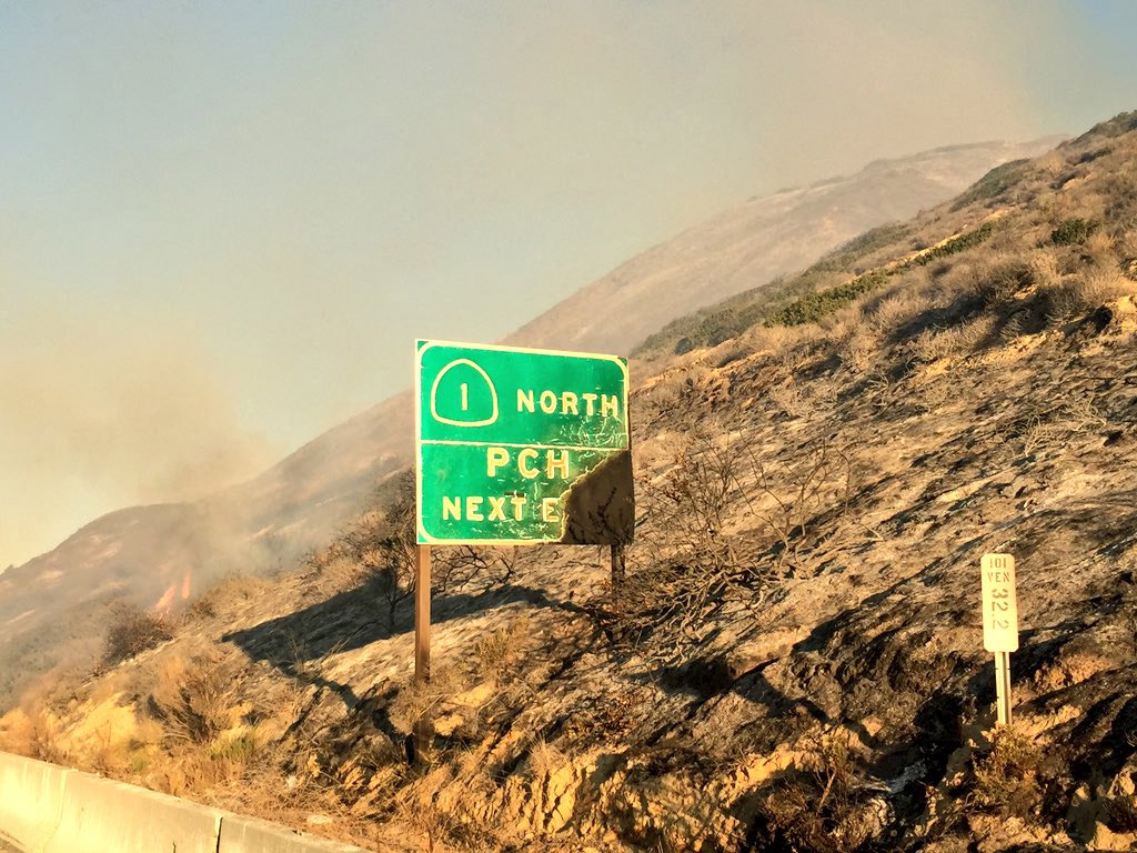 <div class='meta'><div class='origin-logo' data-origin='none'></div><span class='caption-text' data-credit='KABC'>Reporter Chelsea Edwards captured a photo of a burned roadway sign near Ventura.</span></div>