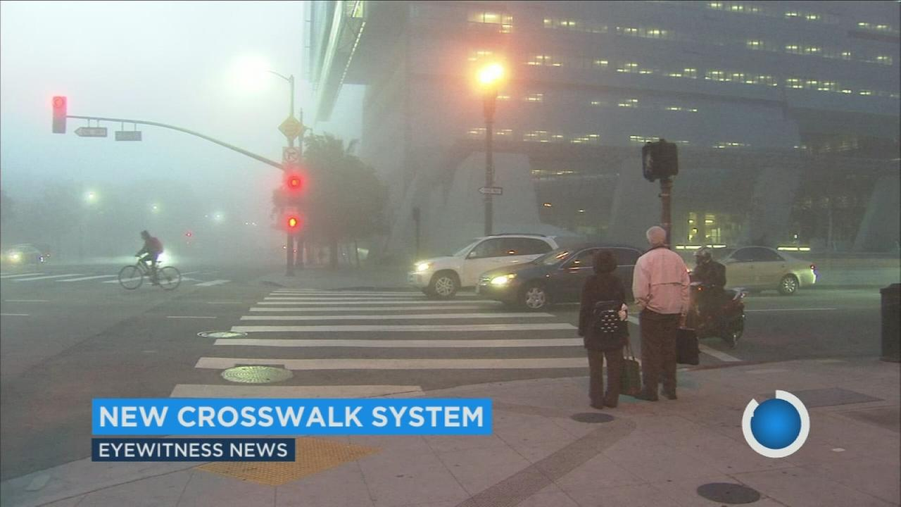 City officials have installed 16 traffic signals in downtown Los Angeles that give pedestrians a four-second head start in crosswalks.