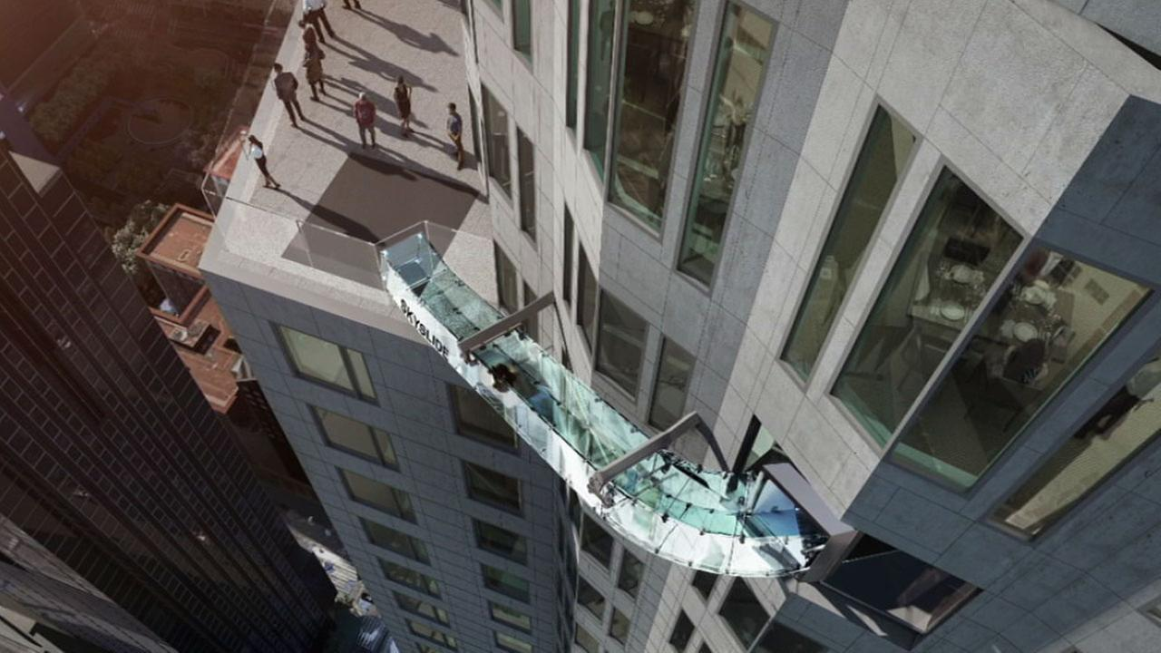 This rendering provided by Overseas Union Enterprise Limited shows a glass slide 1,000 feet above the ground off the side of the US Bank Tower in downtown Los Angeles.