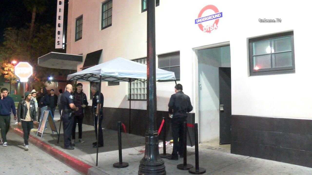 Police are seen outside the Underground DTSA nightclub, where a man was fatally stabbed on Thursday, March 3, 2016.
