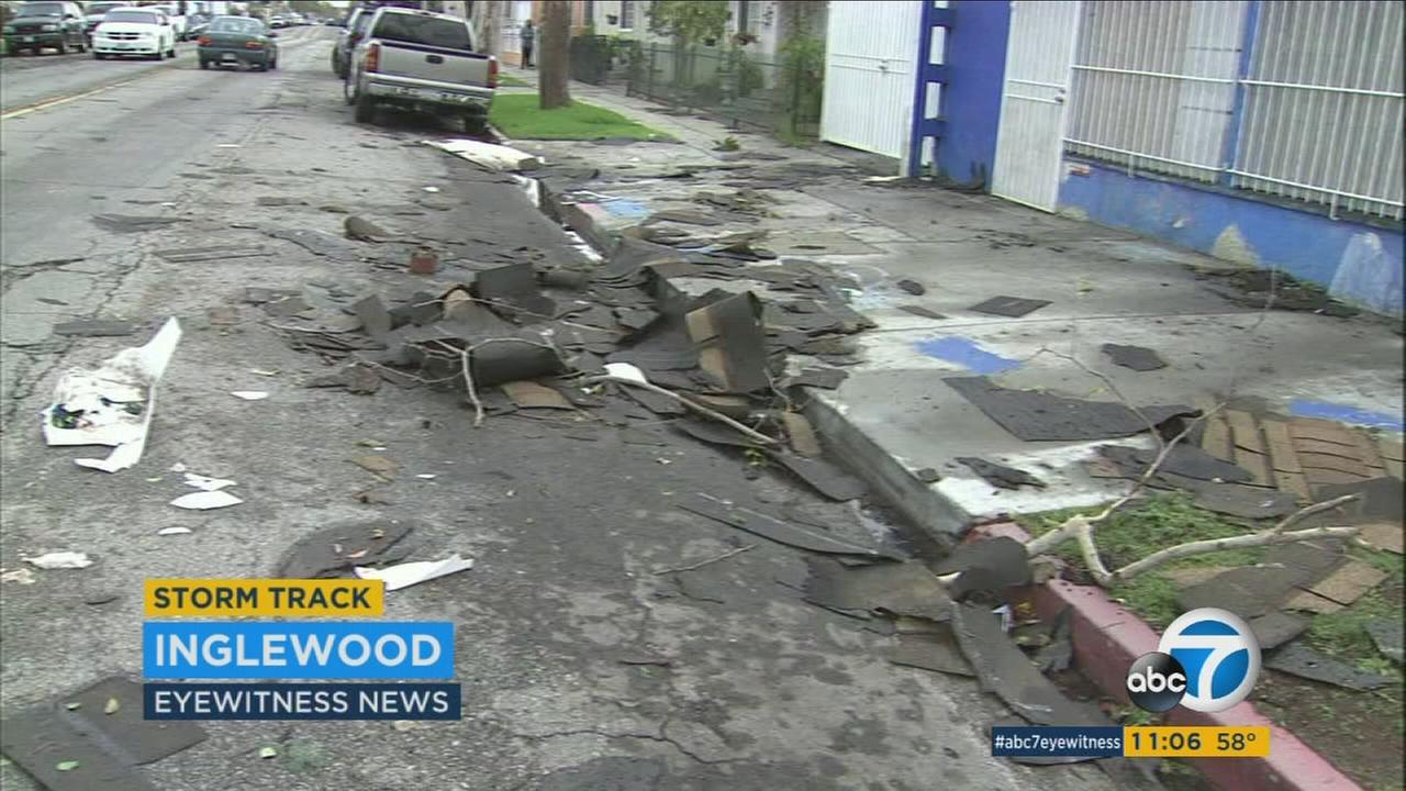 Strong downburst winds hit the 900 block of E. Hyde Park Boulevard in Inglewood Monday, March 7, 2016, ripping trees from the ground and roofs off the buildings.