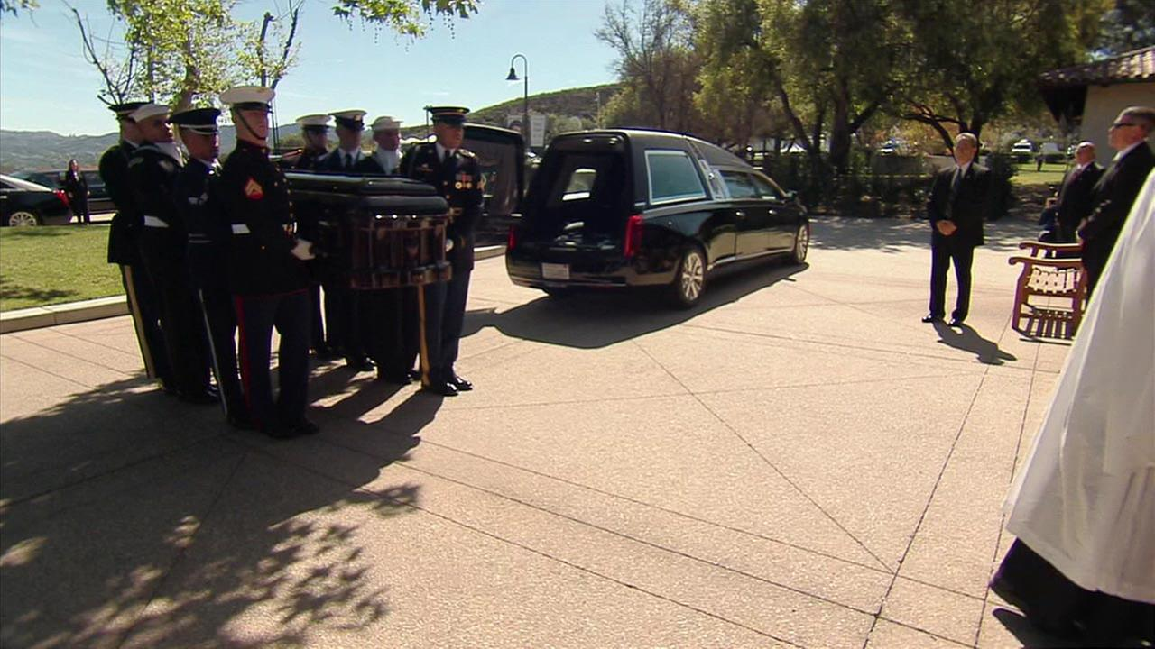 Members of the armed services carry Nancy Reagans casket at the Ronald Reagan Presidential Library on Wednesday, March 9, 2016.KABC