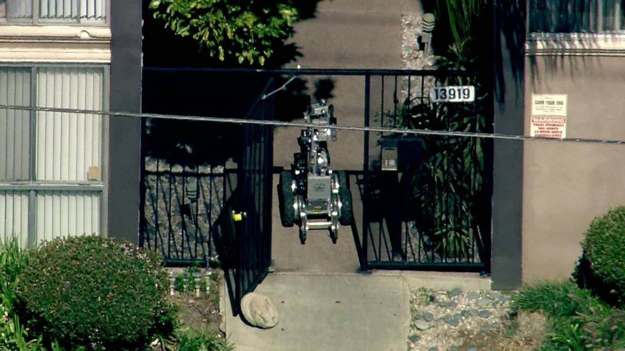 AIR7 HD video shows a robot entering an apartment building in the 13900 block of Burbank Boulevard in Van Nuys Thursday, March 10, 2016.