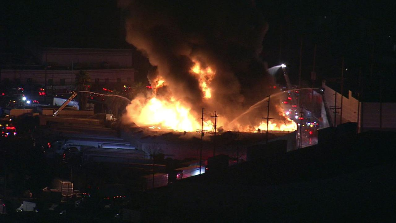 Flames erupt from a single-story commercial building in Boyle Heights on Thursday, March 10, 2016.
