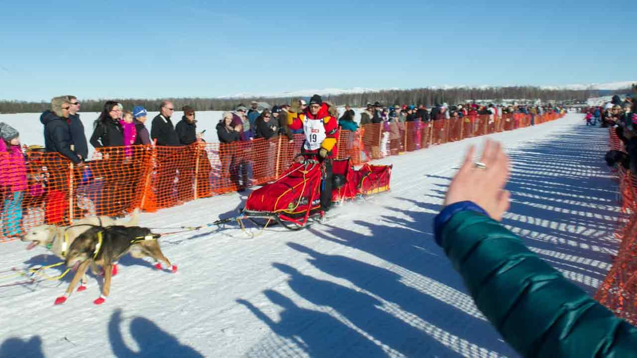 Iditarod Trail Sled Dog Race musher Mitch Seavey begins his race to Nome amongst a crowd of spectators Sunday, March 6, 2016 in Willow, Alaska.