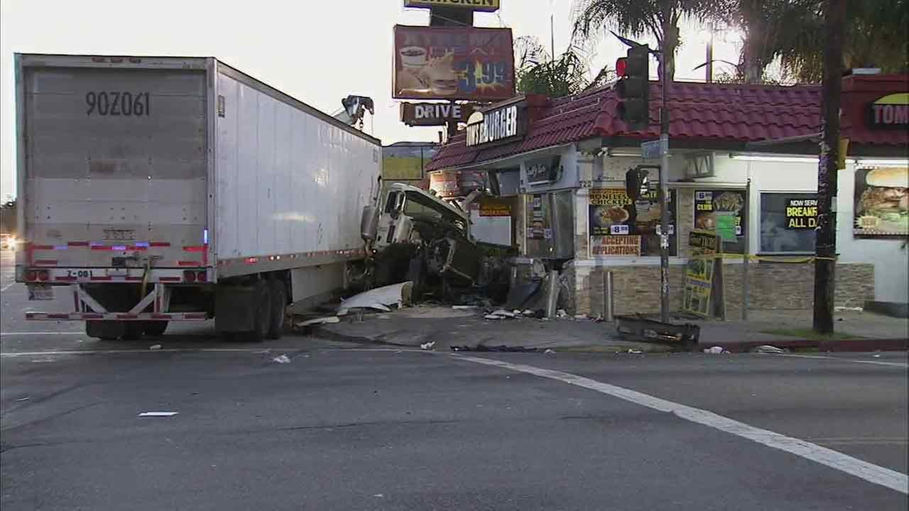 Parts of a big rig seen crushed after it slammed into a burger joint in South Los Angeles early Sunday, March 13, 2016.