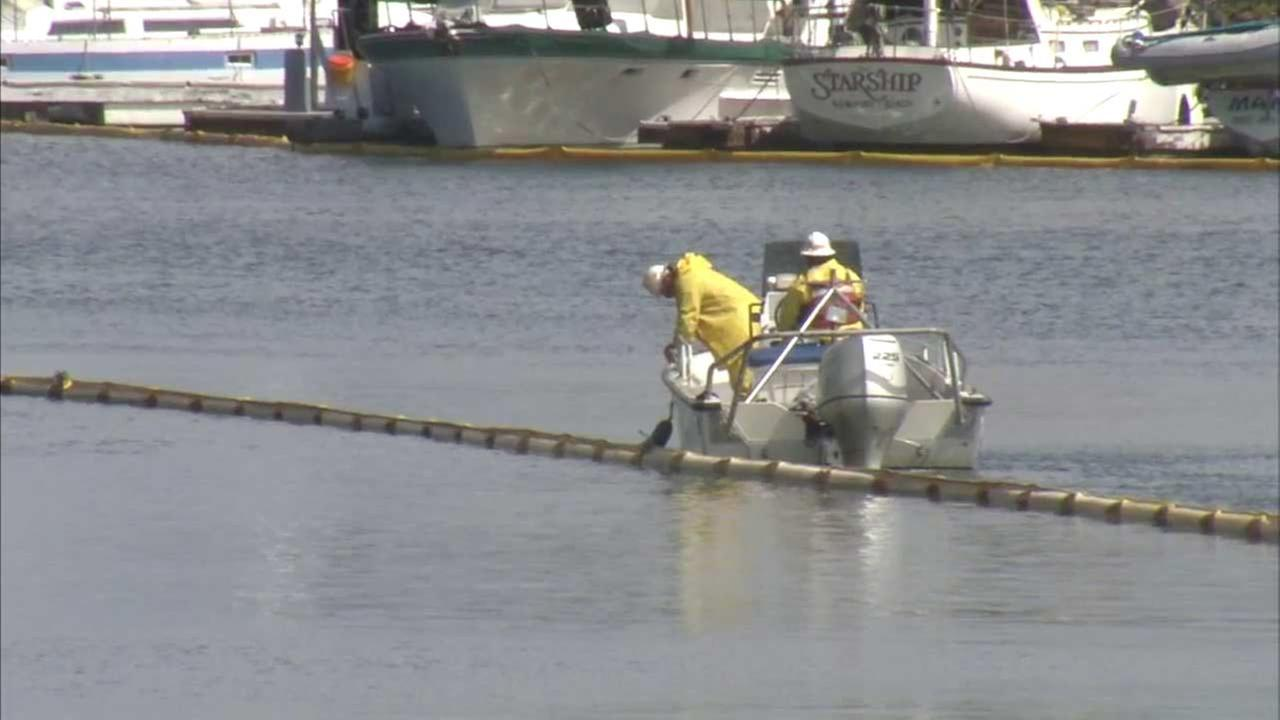 Officials are using booms and pads to help clean a fuel oil spill in the Los Angeles Harbor.