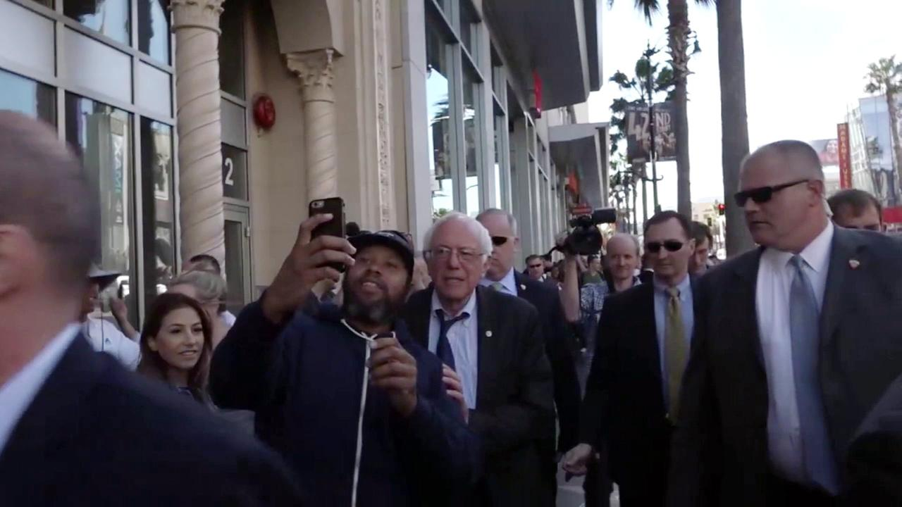 Sen. Bernie Sanders strolled around Hollywood to meet fans and take selfies before a taping of Jimmy Kimmel Live! on Tuesday, March 22, 2016.