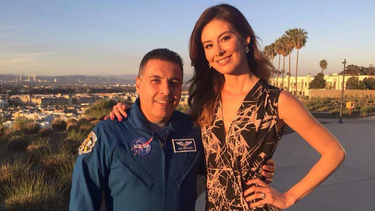 Patricia Lopez smiles with astronaut Jose Hernandez in a photo for Vista L.A.