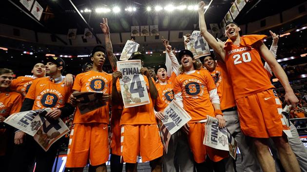 Syracuse players celebrate after an NCAA college basketball game against Virginia in the regional finals of the NCAA Tournament, Sunday, March 27, 2016, in Chicago.