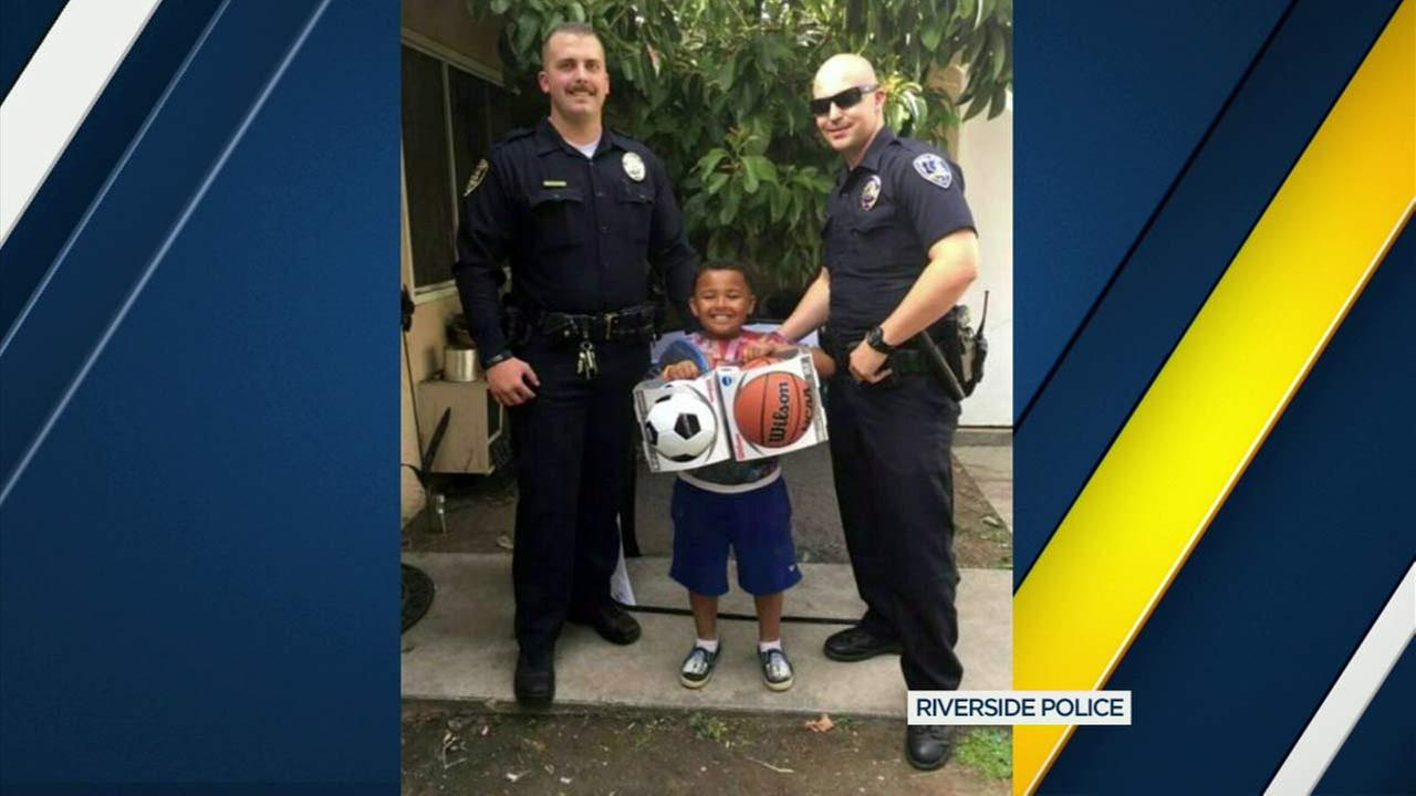 Two Riverside police officers bought a boy two new soccer and basketballs after accidentally running over his soccer ball.