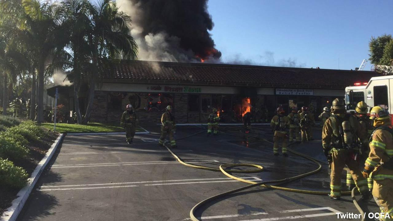 Firefighters battle a fire at a sushi restaurant in Mission Viejo on Friday, April 1 2016.