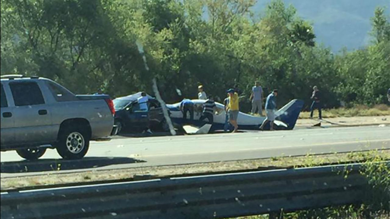 A small plane crashed into a vehicle on the northbound 15 Freeway in San Diego County on Saturday, April 2, 2016.