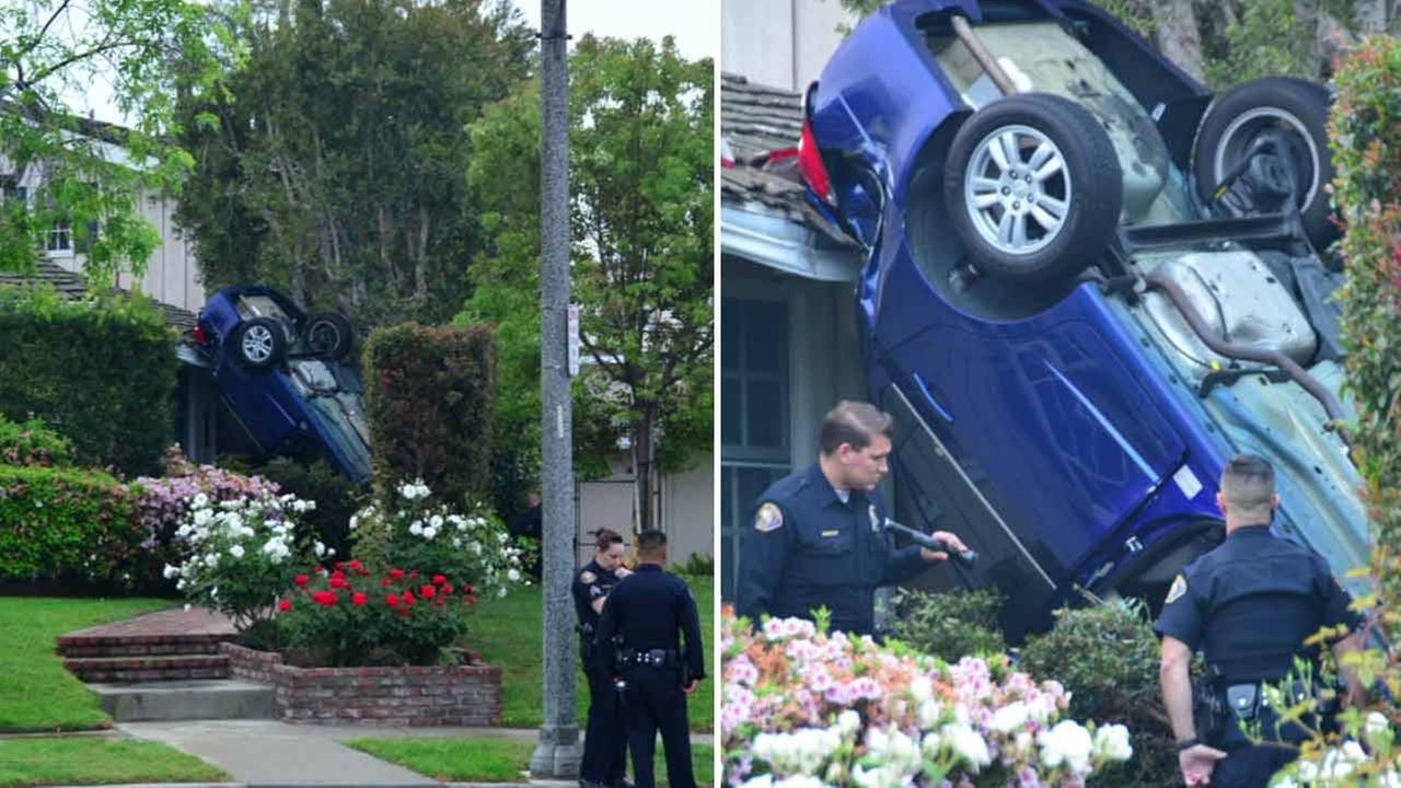 Police investigate a frightening and mysterious crash of a vehicle that landed on top of a home in Long Beach, Calif., on Saturday, April 2, 2016.