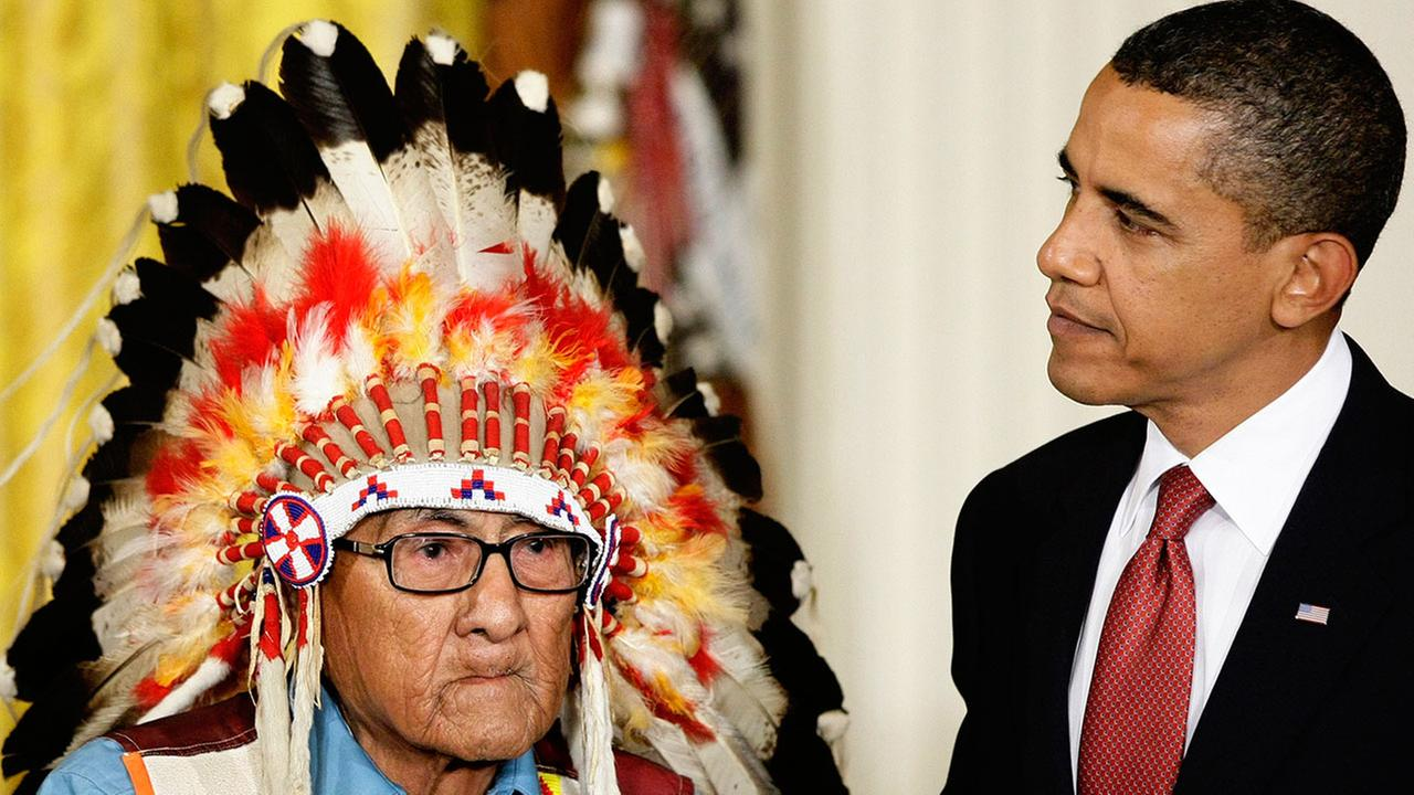 President Barack Obama presents the 2009 Presidential Medal of Freedom to Joseph Medicine Crow during ceremonies at the White House in Washington, Wednesday, Aug. 12, 2009.