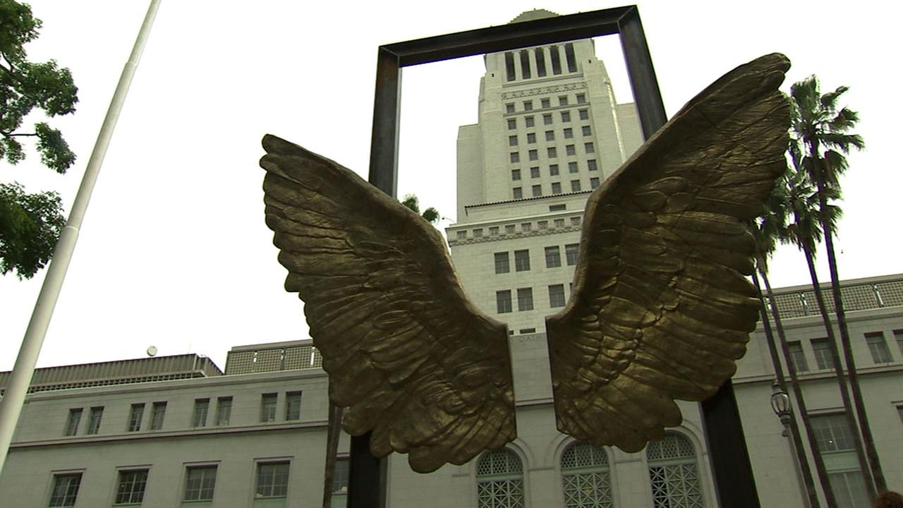 A bronze wings sculpture is shown in front of Los Angeles City Hall on Thursday, April 7, 2016.