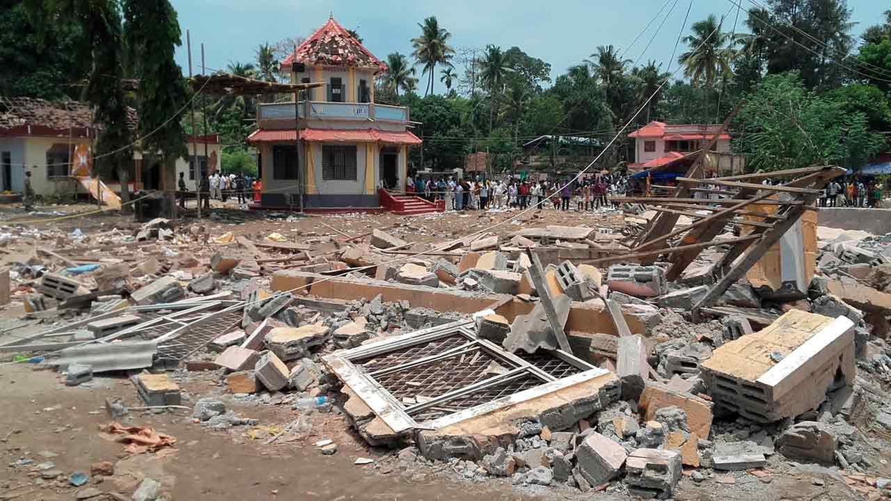 A view of a collapsed building after a massive fire broke out during a fireworks display at the Puttingal temple complex in Paravoor village Sunday, April 10, 2016.