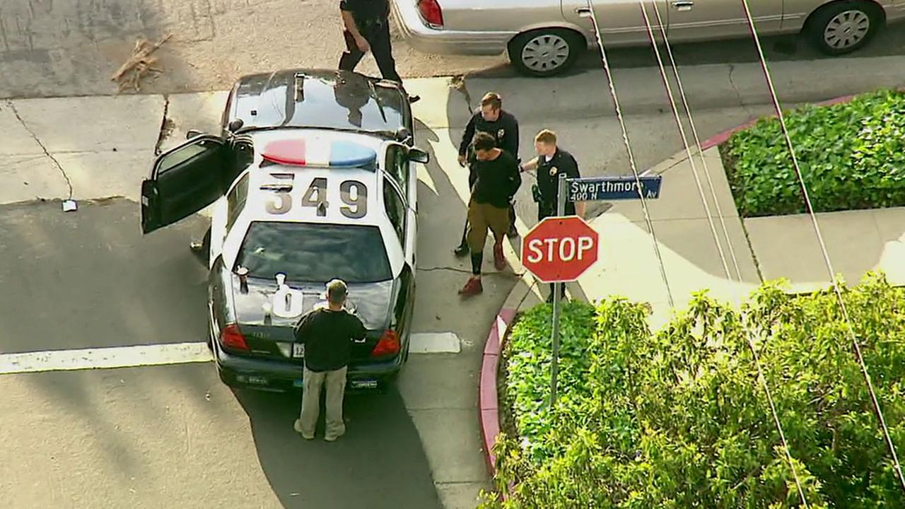 A suspect was taken into custody following an hours-long barricade near Radcliffe Avenue and Earlham Street in Pacific Palisades Monday, April 11, 2016.