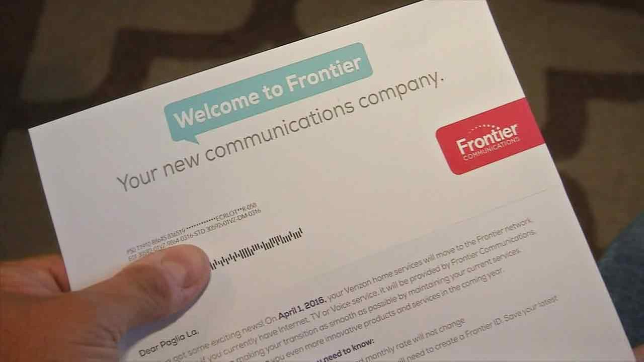 An angry customer holds a letter that states his Verizon home services have moved to the Frontier Communications network.