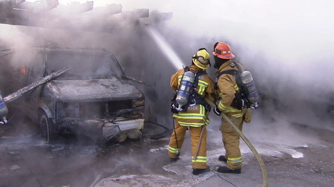 Firefighters put out a fire at a carport behind a Monrovia apartment building on Saturday, June, 21, 2014.