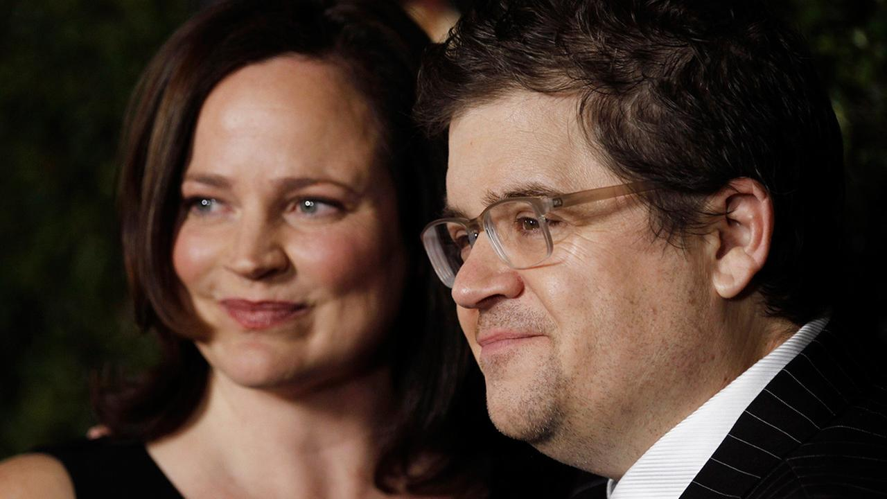 Patton Oswalt, right, and Michelle Eileen McNamara arrive at the premiere of Young Adult in Beverly Hills, Calif., Thursday, Dec. 15, 2011.