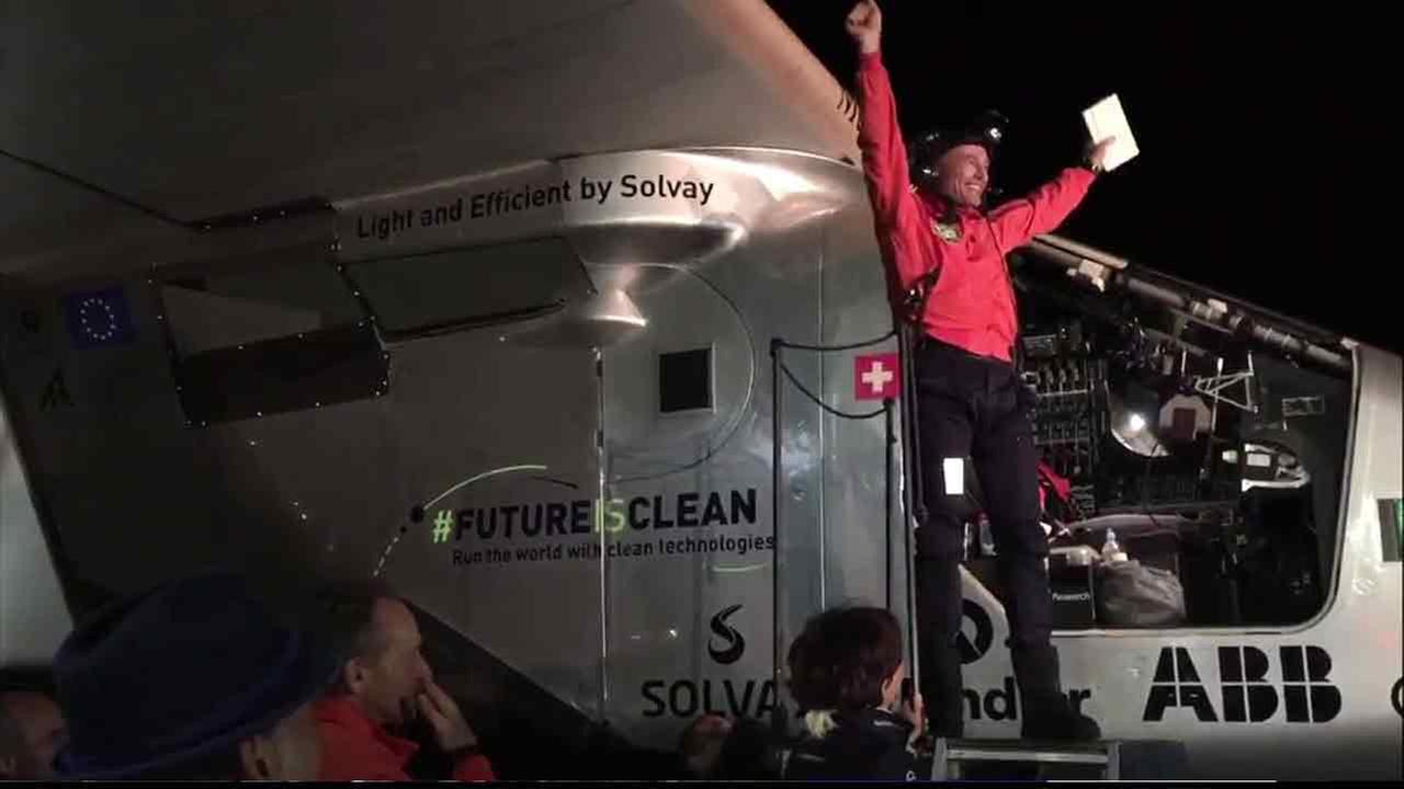 One of two pilots throws his hands up after successfully landing a solar-powered plane in Mountain View on Saturday, April 24, 2016.