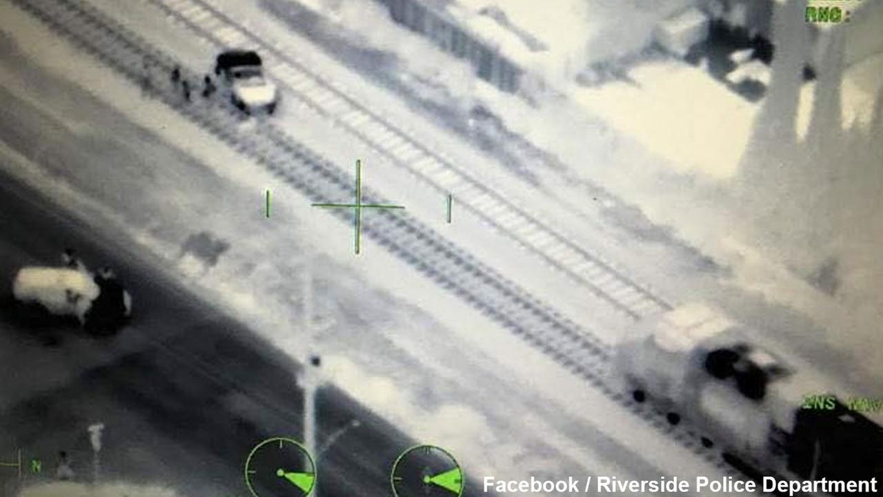 This photo provided by the Riverside Police Department shows a car stuck on train tracks in Riverside on Sunday, April 24, 2016.