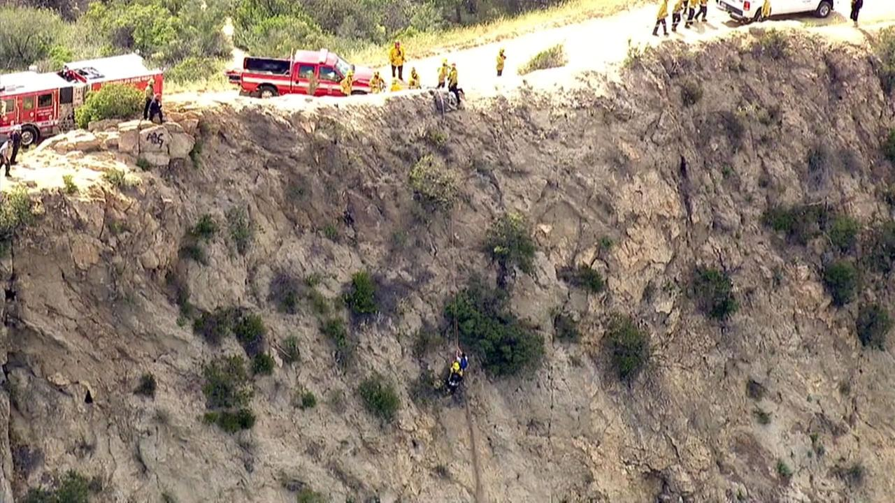 Los Angeles Fire Department officials rescue a stranded hiker on the side of a steep hillside in Griffith Park on Monday, April 25, 2016.