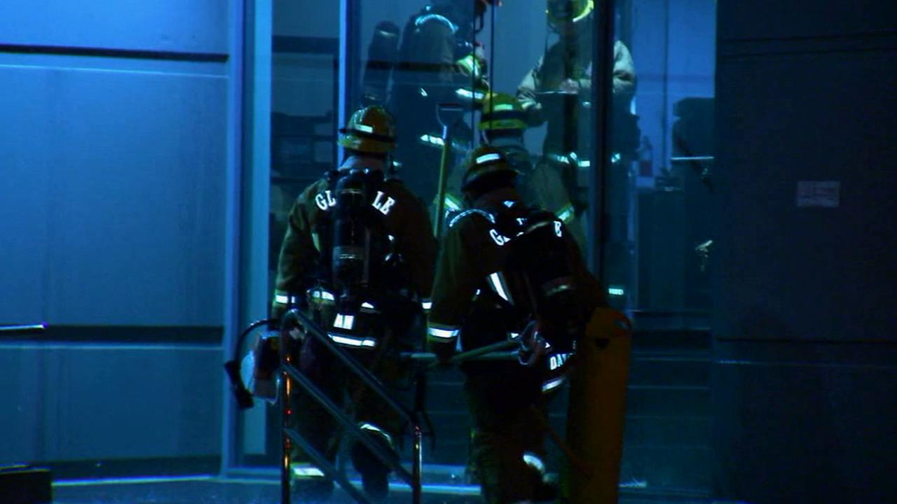Firefighters enter a Burbank high-rise building that caught on fire on Saturday, June 21, 2014.