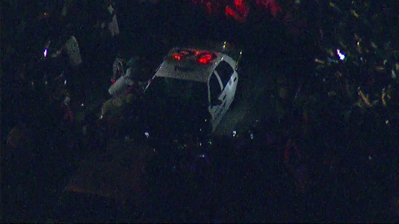 Protesters rock a police car outside the Donald Trump rally in Costa Mesa.
