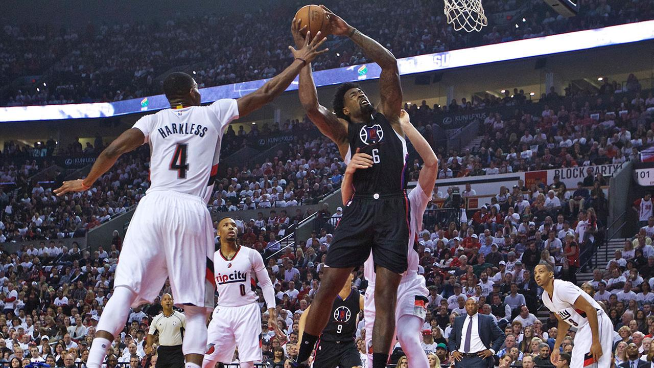 Los Angeles Clippers center DeAndre Jordan shoots as Portland Trail Blazers forward Maurice Harkless, left, defends during the Clippers playoff-elimination loss April 29, 2016.
