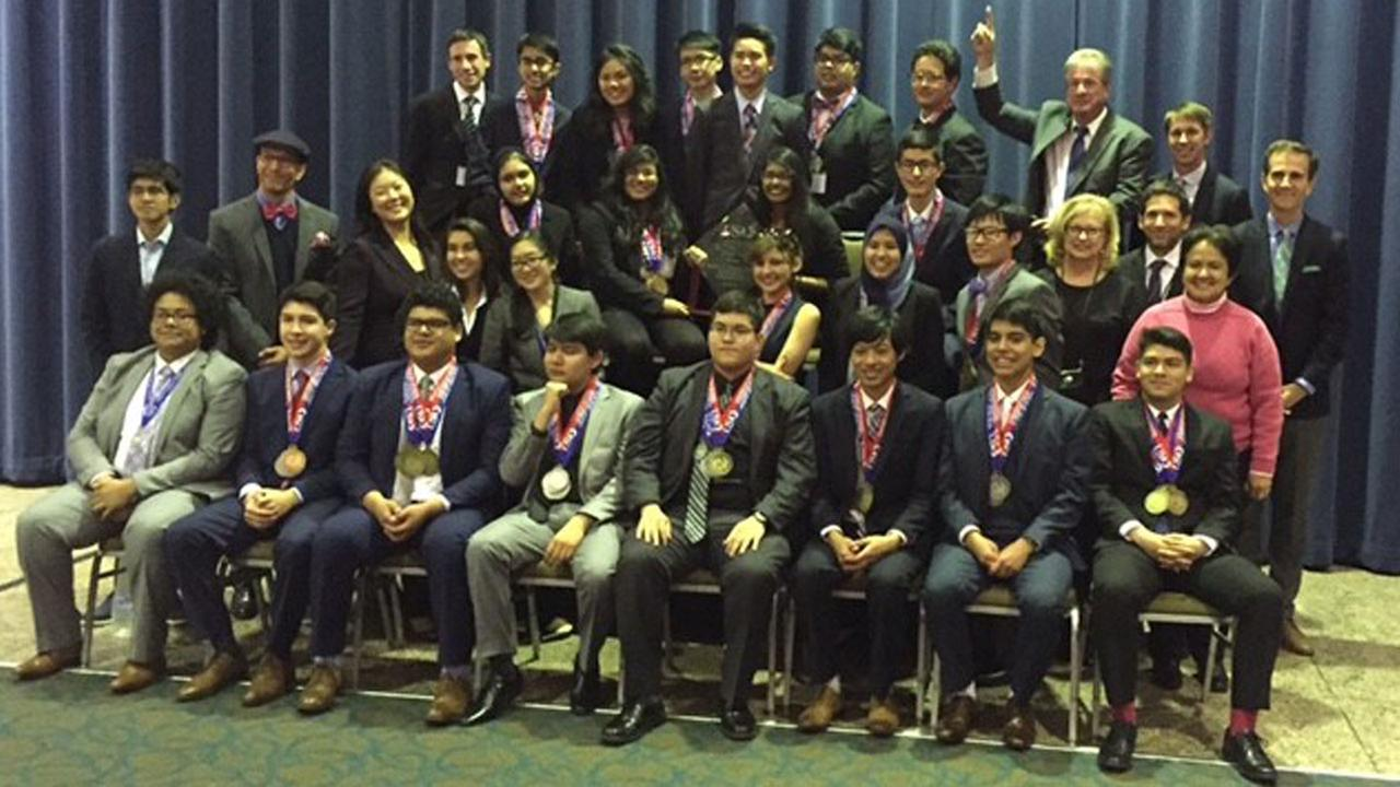 Members of the Granada Hills Charter High School team pose for a photo after winning the U.S. Academic Decathlon on Saturday, April 30, 2016.