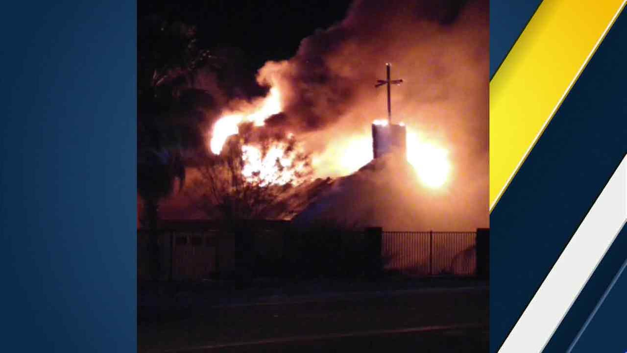 A massive fire erupts inside a church in Homeland, Calif., on Saturday, April 30, 2016.