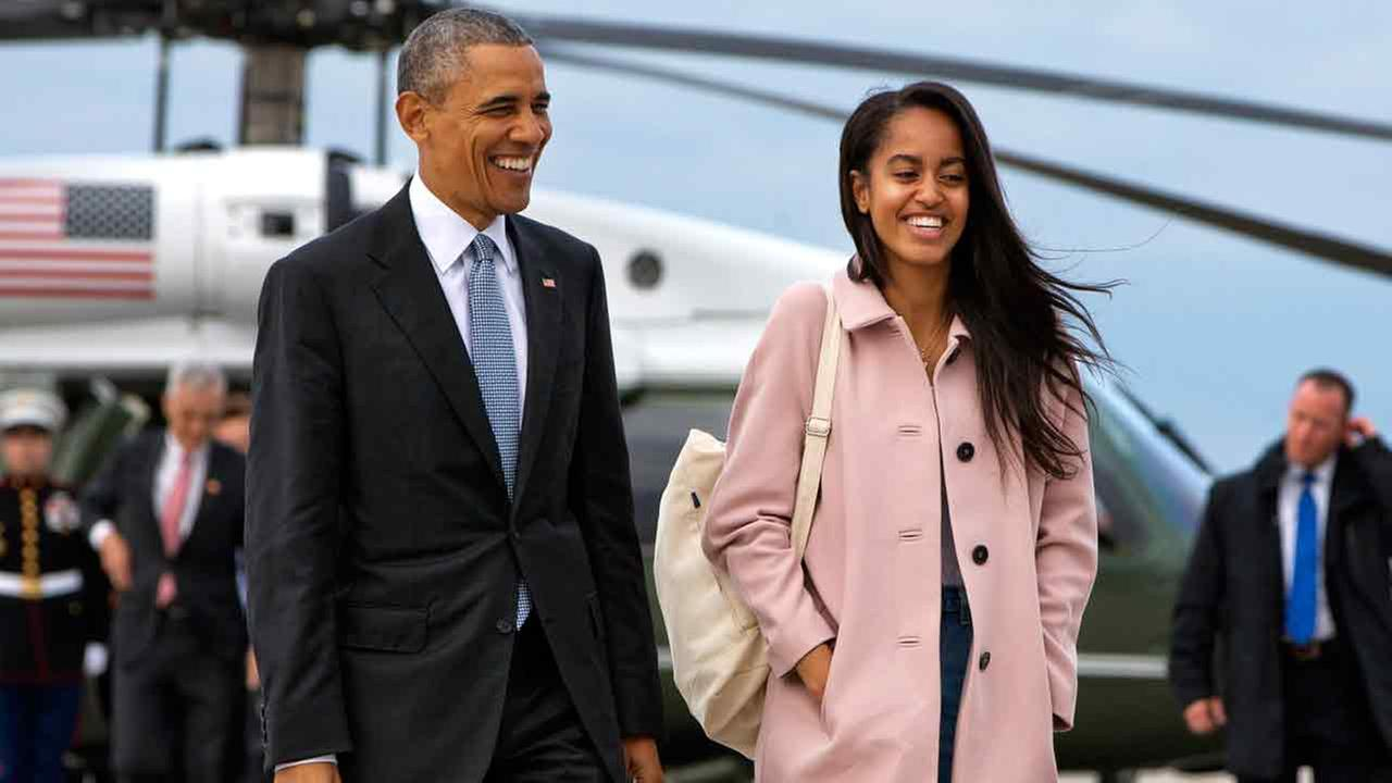In a Thursday, April 7, 2016 file photo, President Barack Obama jokes with his daughter Malia Obama as they walk to board Air Force One.