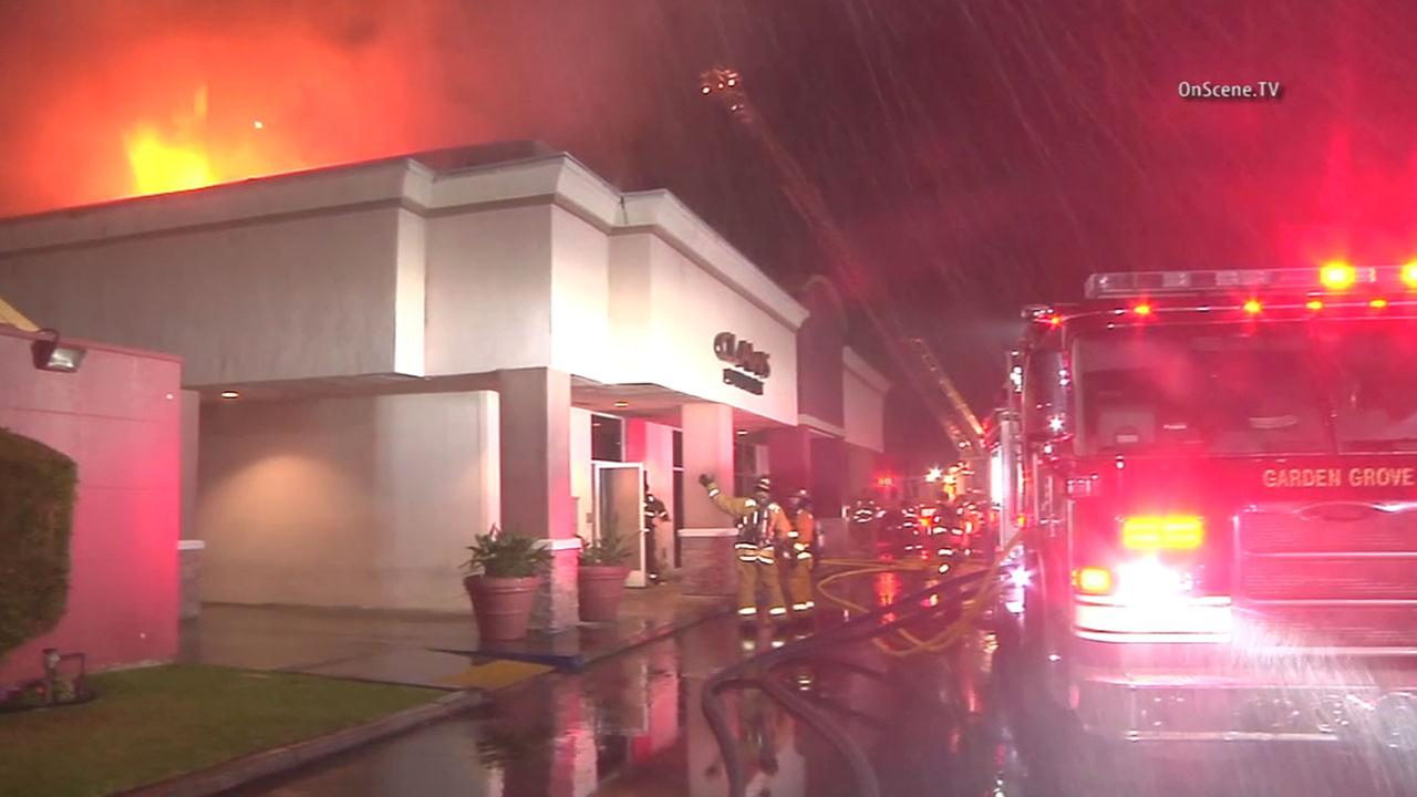 Firefighters work to put out a blaze at Claws Restaurant in Garden Grove on Wednesday, May 4, 2016.